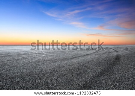Car racing track and beautiful sky clouds at sunset