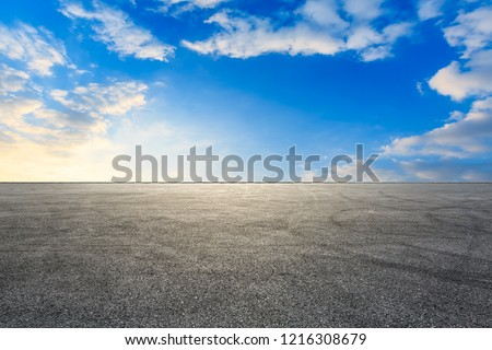 Car racing track asphalt square pavement and beautiful sky clouds scenery at sunset #1216308679