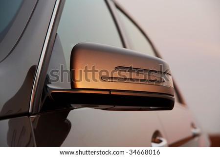 Car rear view mirror closeup