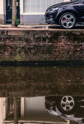 Car reflection on a canal