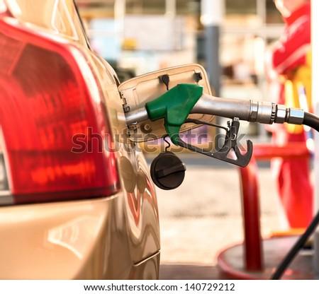 Car refueling on a petrol station .