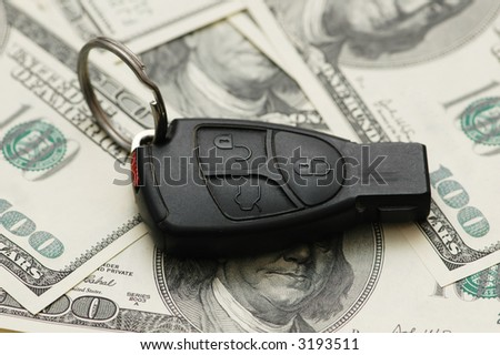 Car remote over  the hundred dollar banknotes