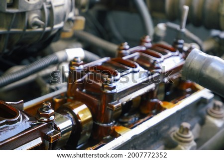 Car repair. Internal combustion engine repair. Deposits of tar from low-quality oil on the engine timing mechanism. Photo stock ©
