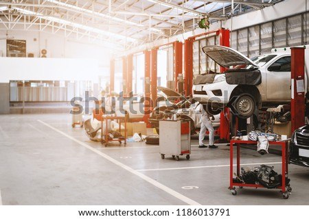 car repair station with soft-focus and over light in the background #1186013791
