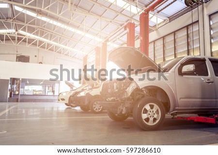 car repair station with soft-focus in the background and over light