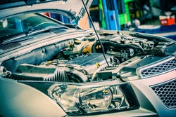 Car Repairing. Modern Compact Car with Open Hood. Car Under Maintenance.