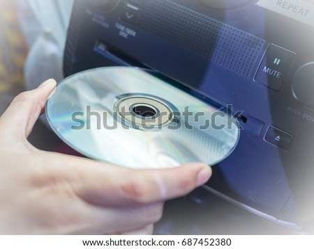 Car's driver insert CD in to CD player