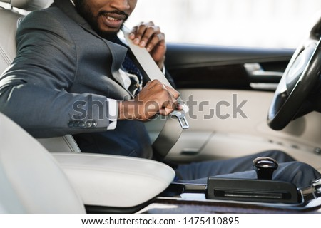 Car safety. Business man fastening seat belt in auto, driving to work, copy space #1475410895