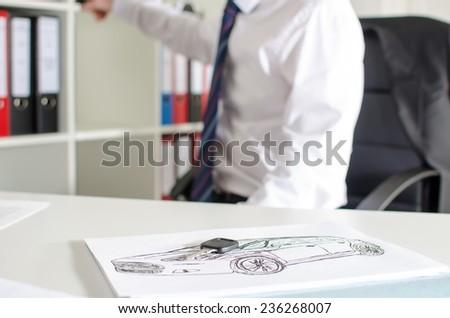 Car salesman at the dealership office