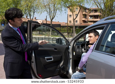 Car Salesperson and Prospect Customer