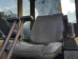 Car seat for trackhoe old and rust