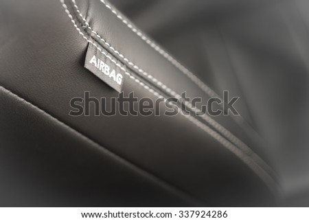 Car seat side airbag label on luxury leather - increased safety in a car - health protection