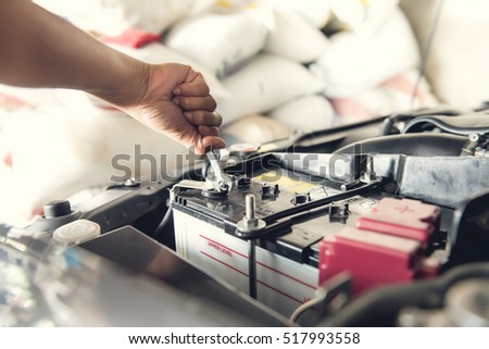 Car service ,fitting a car battery with wrench