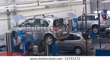 car service with cars on elevators examining by mechanics