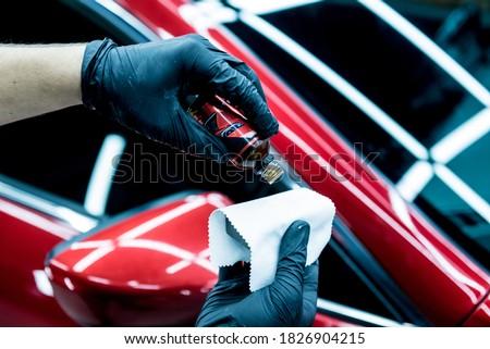 Car service worker applying nano coating on a car detail. Сток-фото ©