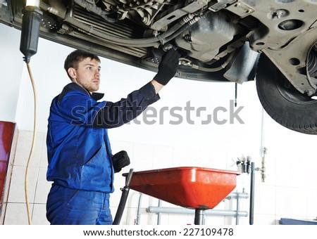 Car servicing, replacing of motor oil and filter at auto repair shop