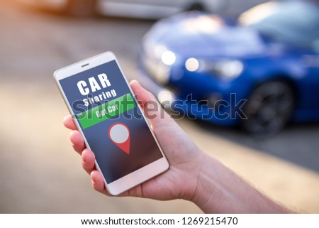 Car sharing and rental concept. Customer calling a taxi through the mobile app. Rent a car for short trips around the city. Sharing Economy. Taxi online and sharing concept