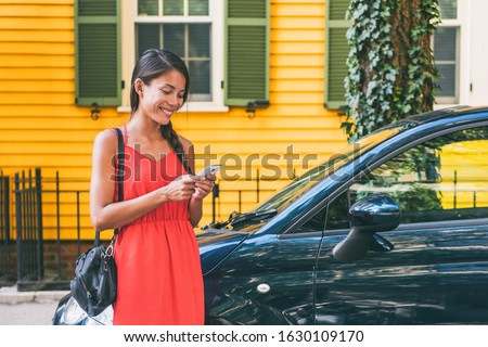 Car sharing mobile phone tech lifestyle. Ridesharing app Asian woman using cellphone for travel vacation.