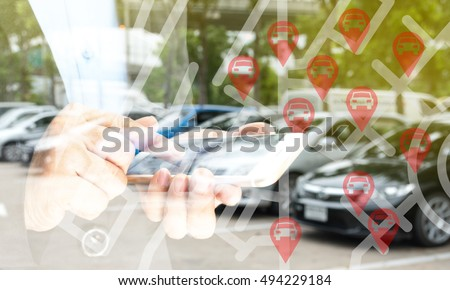 Car sharing service or rental concept. Sharing economy and collaborative consumption. Double exposure of business man holding mobile phone and use application to call car with blur background Stock photo ©