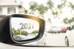 Car side mirror with 2021 on blurred background for customers. for transport or automotive automobile industrial and happy new year 2021 image.