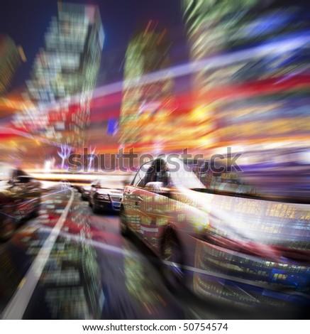 car speeding on the street wiht motion blur building background in night.