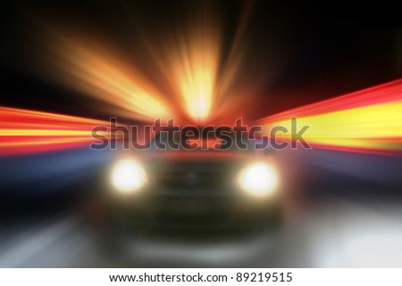Car speeding towards camera, bright background