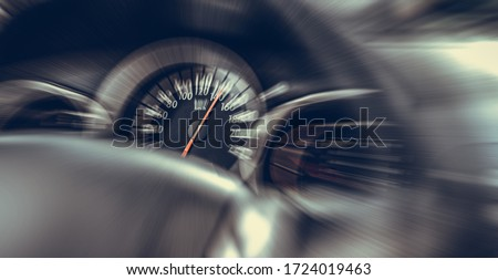 Photo of  Car speedometer. High speed on a car speedometer and motion blur.