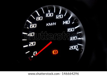 car speedometer on black background