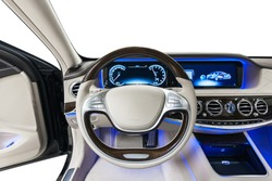 Car steering wheel. Beige leather dashboard, climate control, speedometer, display, wood decoration & blue ambient light