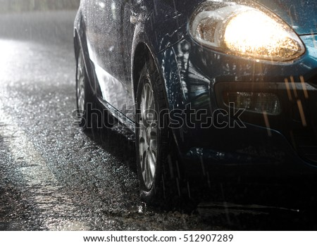 Car stops in the rain