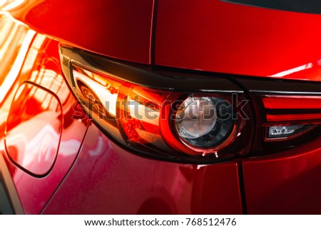 Car tail light red color for customers. Using wallpaper or background for transport and automotive image