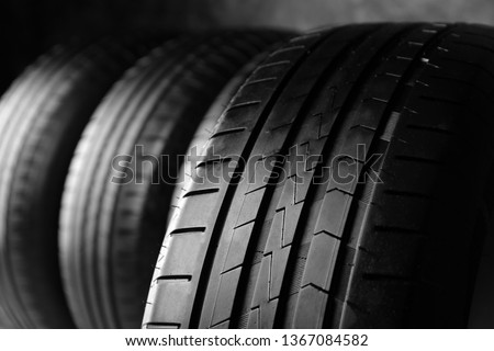 Car tire, closeup #1367084582