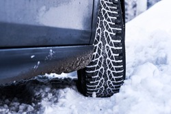 Car tire in winter with snow, Detail of car tire in winter. Snow tire in winter time