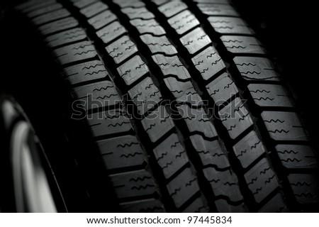 Car Tire on Black Background. Car Tire in the Dark - Spot Light