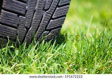 car tire on the green grass