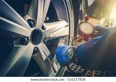 Shutterstock Car Tire Pressure Check in the Auto Service Garage.