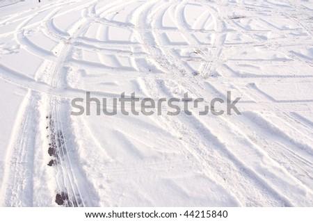Car tire track in fresh light snow