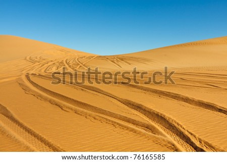 Car tire tracks in the desert - Awbari Sand Sea, Sahara, Libya