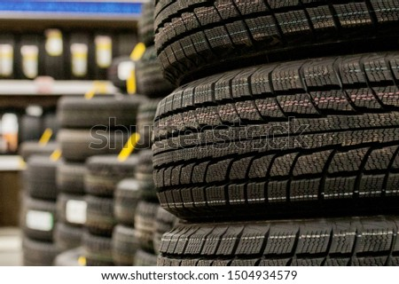 Car tires and wheels at warehouse in tire store