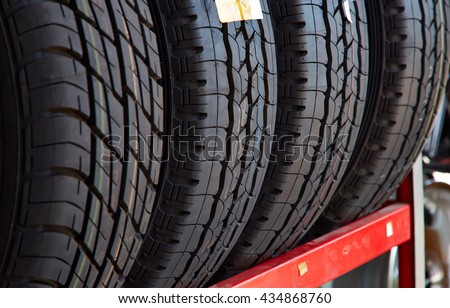 Car tires at warehouse in tire store, New four tires, Horizontal photography