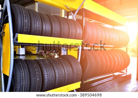 Car tires at warehouse with sun rays.
