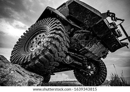 Car tires concept on off road. Shock absorber. Travel and racing concept for 4x4 drive off road vehicle Stock photo ©