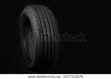 Car tires on black background. Shop Tires and wheels.