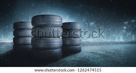 Car tires on wet roadway