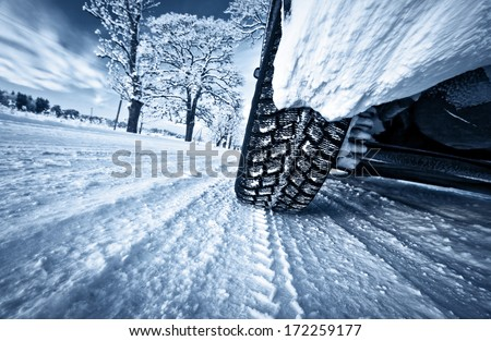 Car tires on winter road #172259177