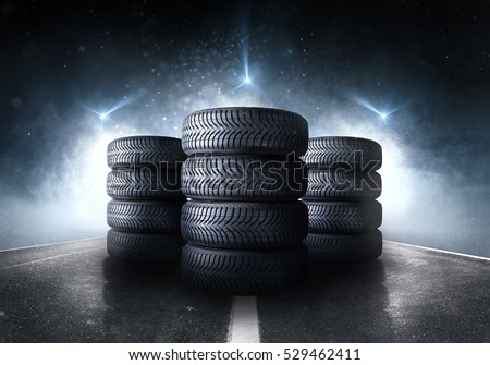 Car tires standing on a road