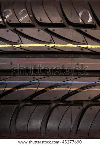 Car tires stripes close up