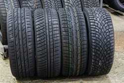 car tires with different treads for summer, all season, winter and winter with studs