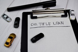 Car Title Loan write on document with toys car isolated office desk