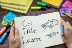 Car title loans is shown on a business photo using the text